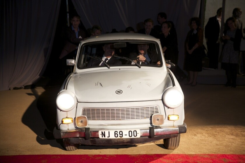 Wende Museum founder Justin Jampol and publisher Benedikt Taschen drove a vintage Trabant into the exhibition at the Culver City museum.