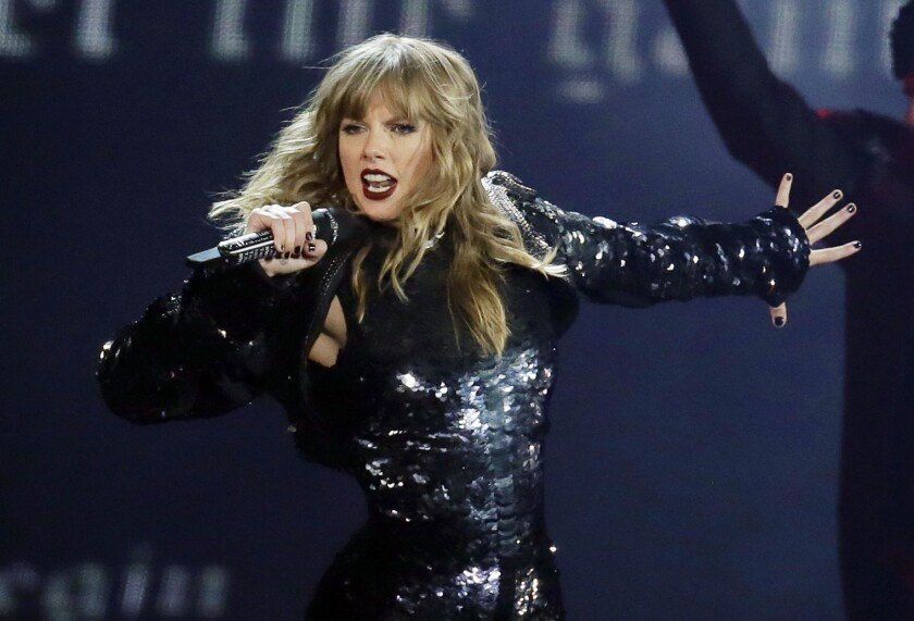 "FILE - In this May 8, 2018, file photo, Taylor Swift performs during her ""Reputation Stadium Tour"" o"