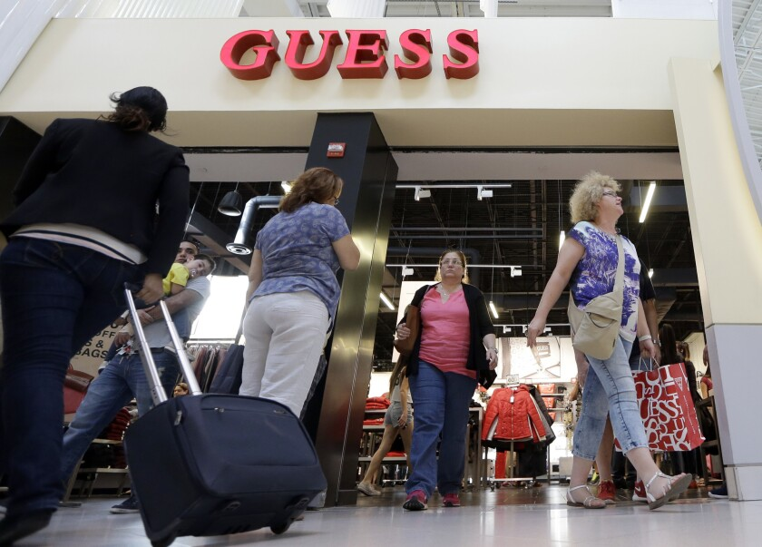 Shoppers at a Guess store