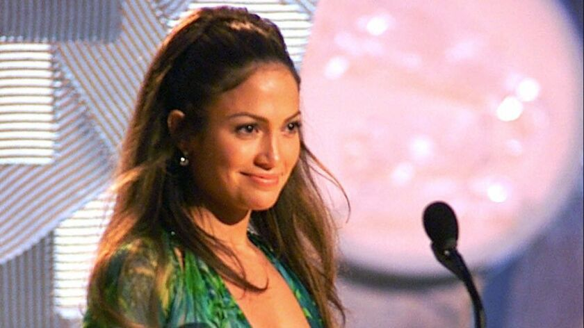 In this Feb. 23, 2000, file photo, Jennifer Lopez, wearing a sheer, low-cut silk chiffon Versace dress, appears on-stage to present an award during the 42nd Grammy Awards in Los Angeles.