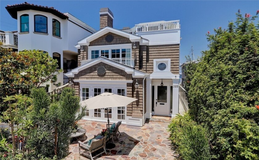 The three-story home takes in ocean views from multiple decks and balconies.