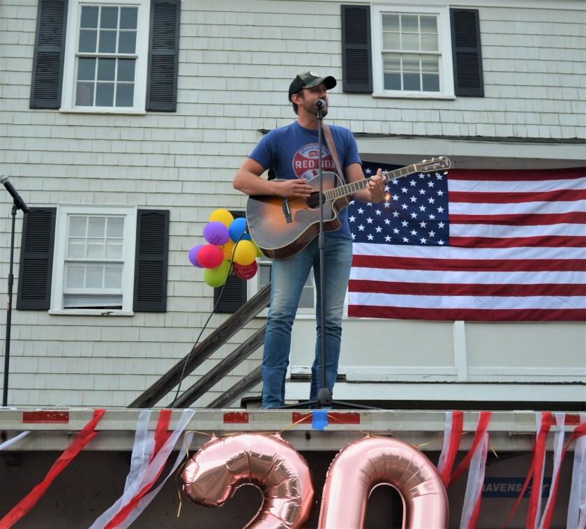 Country singer Drew Baldridge sings at a high school graduation in Dedham, Mass. June 6.