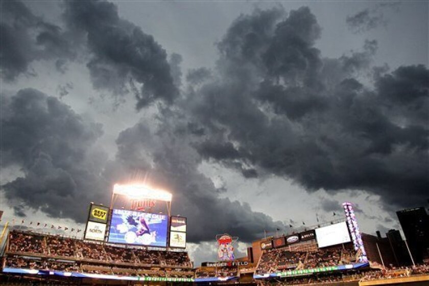 Storm clouds hover over Target field delaying the baseball game between the Milwaukee Brewers and the Minnesota Twins, Friday, July 1, 2011 in Minneapolis. (AP Photo/Andy King)