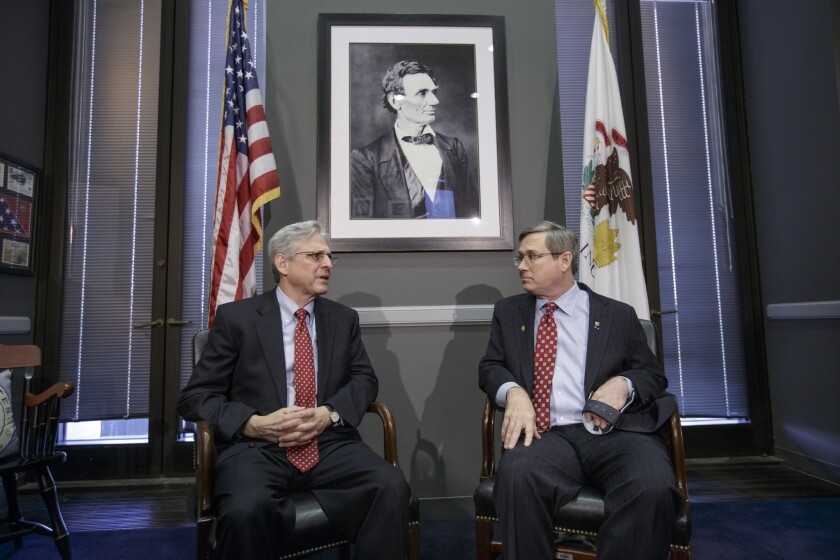 Sen. Mark Kirk (R-Ill.), right, meets in his office on Capitol Hill with Judge Merrick Garland, President Obama's choice for the Supreme Court.