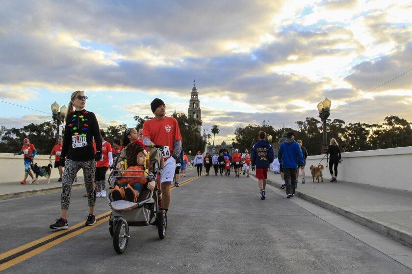The Blacutt family crosses the Cabrillo Bridge in Balboa Park before the 5k.