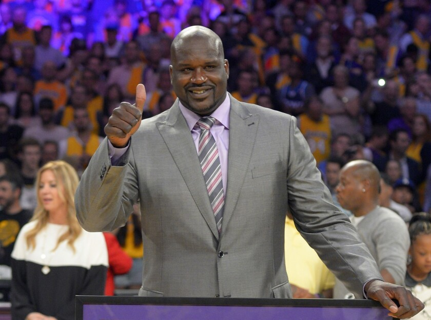 Shaquille O'Neal, shown during his Lakers jersey retirement ceremony, has become a minority owner of the Sacramento Kings.