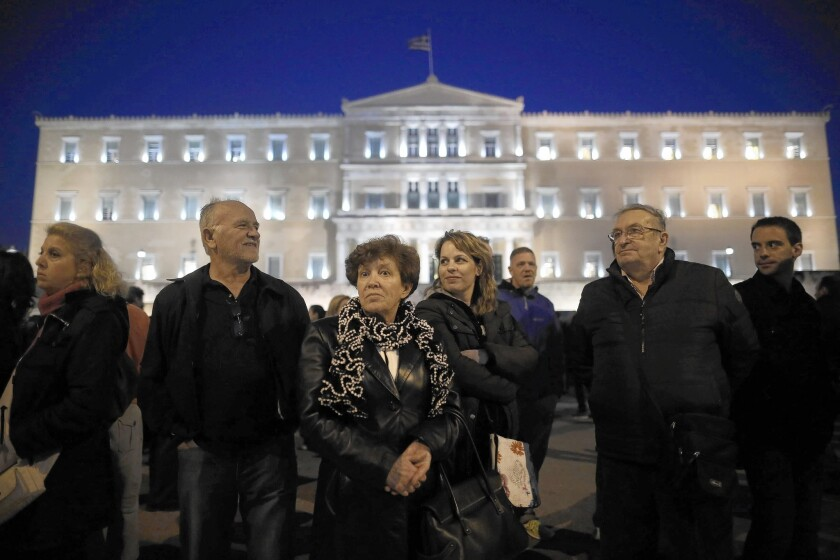 Protesters hold a silent rally outside Parliament in Athens in support of the government's effort to renegotiate with the country's creditors.