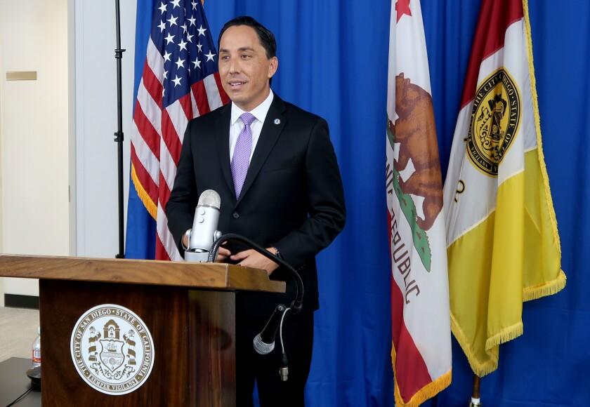 Todd Gloria, San Diego's new mayor, replaced termed-out Mayor Kevin Faulconer, left, in online ceremony