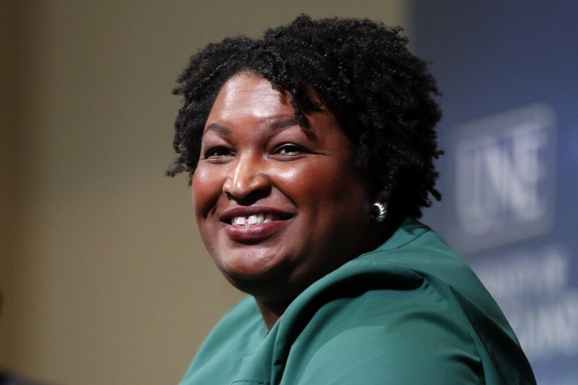 "FILE - Stacey Abrams, a Georgia Democrat who has launched a multimillion-dollar effort to combat voter suppression, speaks at the University of New England in Portland, Maine on Jan. 22, 2020. Berkley announced Tuesday that it had acquired rights to three out-of-print novels by Abrams that she had written nearly 20 years ago under the name Selena Montgomery. Berkley, a Penguin Random House imprint, will begin reissuing the books; ""Rules of Engagement,"" ""The Art of Desire"" and ""Power of Persuasion,"" in 2022. (AP Photo/Robert F. Bukaty, File)"