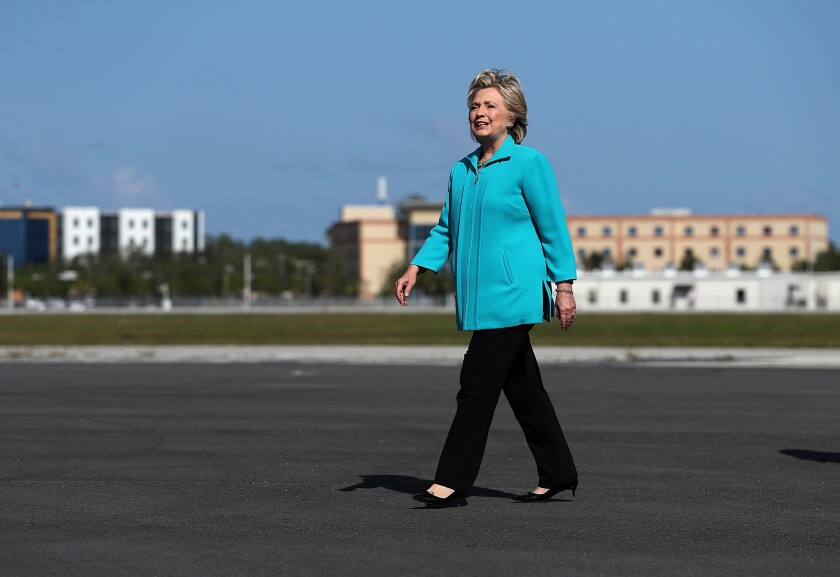 Democratic presidential candidate Hillary Clinton arrives at Daytona Beach International Airport in Florida on Saturday.