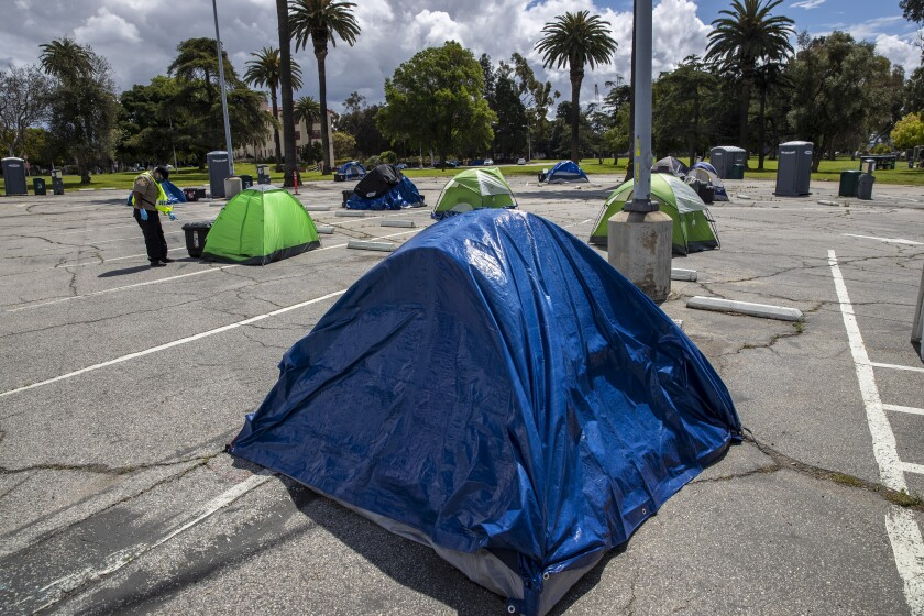 Homeless veterans set up camp in a VA parking lot in Los Angeles on April 8.
