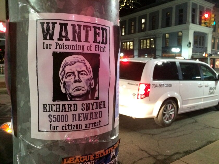 """Not the only guilty party: Poster offers a $5,000 reward for """"citizen arrest"""" of Michigan Republican Gov. Rick Snyder, whose officials played a key role in the Flint water crisis. But where were the scientists?"""