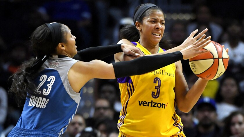 Sparks forward Candace Parks is pressured by Lynx forward Maya Moore during the first half of Game 4 on Sunday.