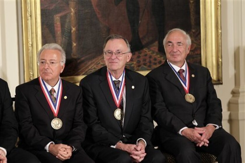 From left, Federico Faggin, Marcian E. Hoff Jr., and Stanley Mazor, the creators of the world's first microprocessor at Intel Corporation, wear the National Medal of Technology and Innovation presented by President Barack Obama at a White House ceremony in Washington, Wednesday, Nov. 17, 2010. (AP