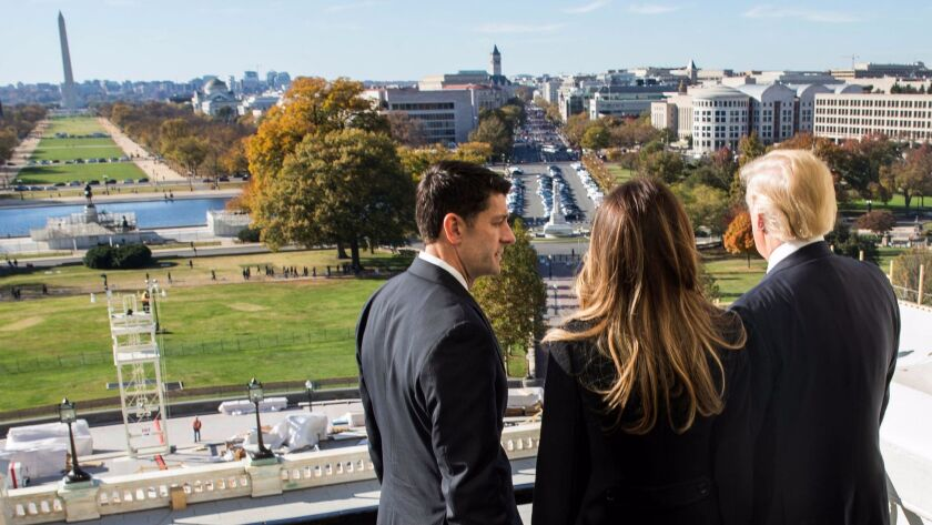 House Speaker Paul Ryan (R-Wis) shows President-elect Donald Trump and his wife, Melania Trump the Speaker's Balcony at the U.S. Capitol on Thursday.
