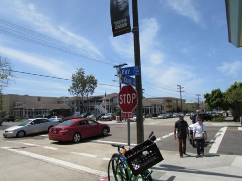 La Jolla resident John Parker says two intersections are responsible for needless rage and out-of-control ego in our town: The intersections of Girard Avenue/Silverado Street (left) and Fay Avenue/Kline Street. Photos by Susan DeMaggio
