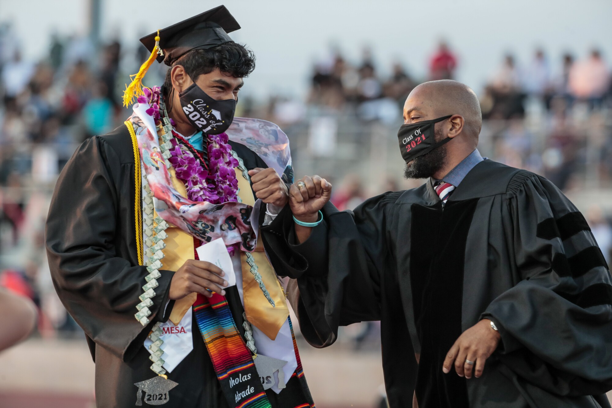 Sierra Vista Principal Vince Pratt fist bumps a graduate