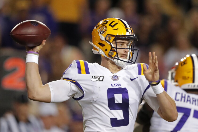 LSU quarterback Joe Burrow passes in the first half against Florida in Baton Rouge, La. on Saturday.
