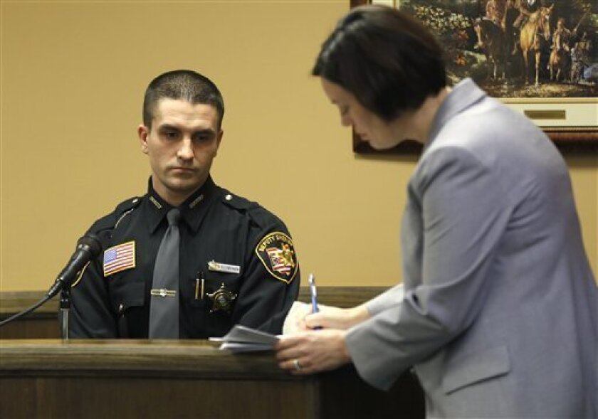 CORRECTS NAME TO AARON ELLENBERGER, NOT ELLEN BERGER - Jefferson County Deputy Sheriff Aaron Ellenberger, left, listens as prosecuting attorney Marianne Hemmeter, right, asks questions during the rape trial for 17-year-old Trent Mays and 16-year-old Ma'lik Richmond in juvenile court on Thursday, Ma