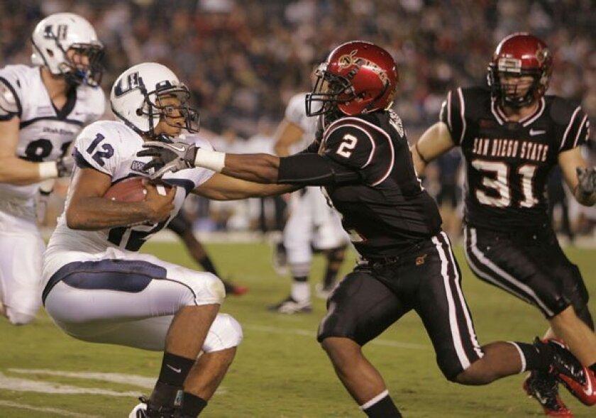 Utah State QB Diondre Borel gets caught by SDSU cornerback Leon McFadden in 2010.