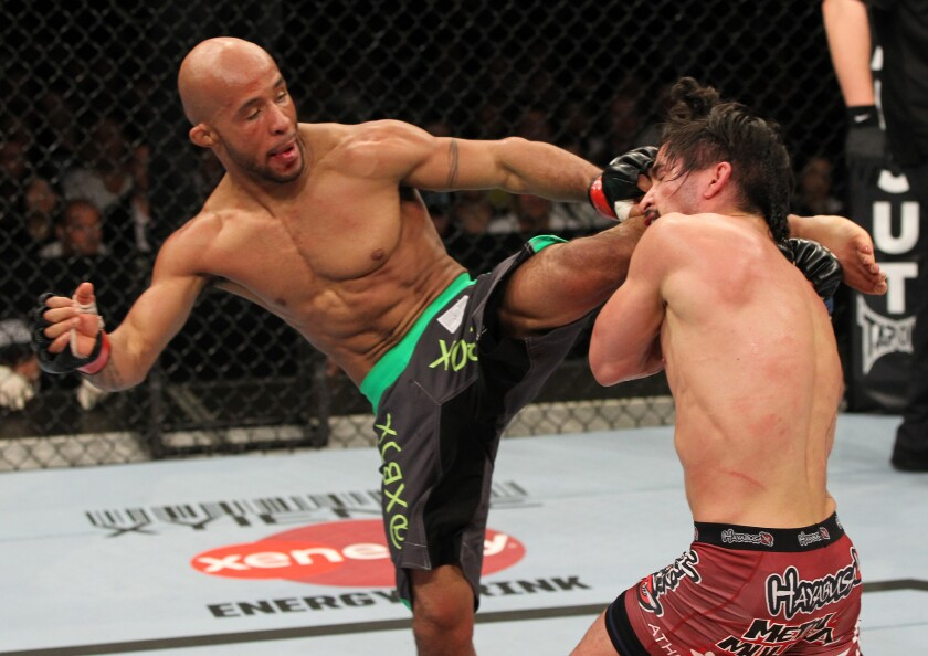 Demetrious Johnson (izq.)