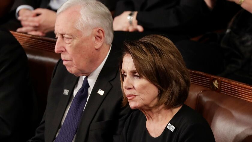 House Minority Leader Nancy Pelosi of California and Minority Whip Steny Hoyer, D-Md., listen to the