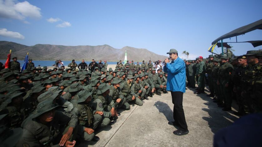 Venezuelan President Nicolas Maduro, center, attends an event with members of the military in Turiamo on Feb. 3, 2019.