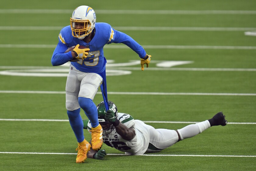Jets linebacker Neville Hewitt pulls on the jersey of Chargers wide receiver Keenan Allen after a catch by Allen.