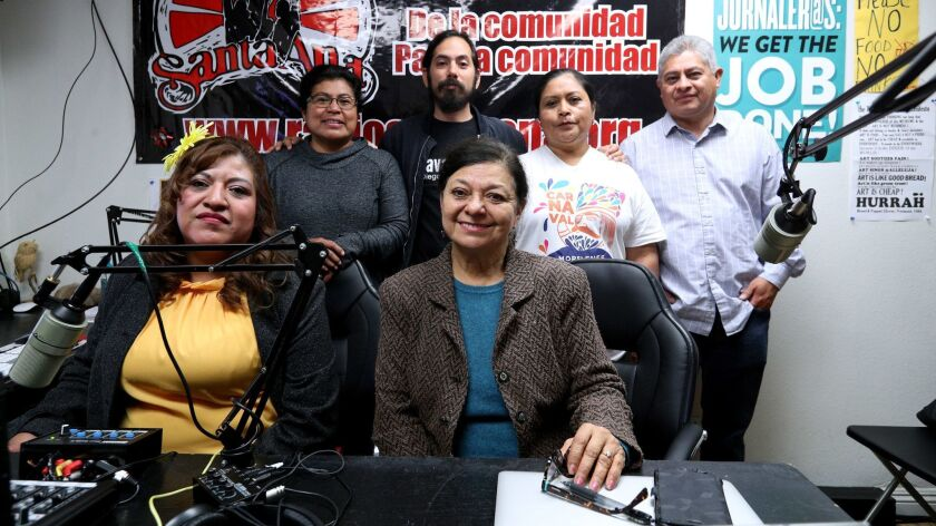 Some of the radio station volunteers include, back row from left, Ester Hernandez, Luis Sarmiento (c