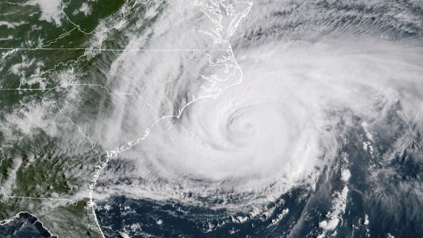 This satellite image provided by NOAA shows Hurricane Florence on the eastern coast of the United St