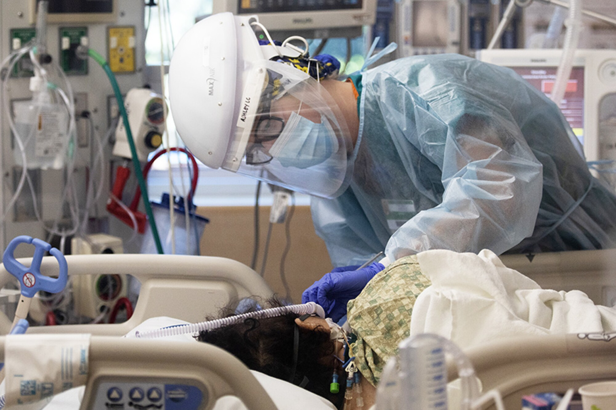 Registered nurse Ashley Cohagen works inside a COVID-19 intensive care unit.