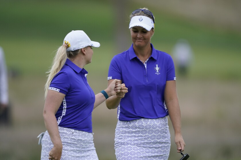Europe's Matilda Castren, left, Anna Nordqvist celebrate on the third hole during the foursome matches at the Solheim Cup golf tournament, Saturday, Sept. 4, 2021, in Toledo, Ohio. (AP Photo/Carlos Osorio).
