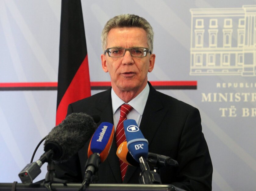 German Interior Minister Thomas de Maiziere speaks at a news conference after meeting with Albanian counterpart Saimir Tahiri, in Tirana, Friday, Nov. 6, 2015.  De Maiziere calls on Albanians to stop asking for political asylum in Germany as there is no ground for their claims. (AP Photo/Hektor Pus