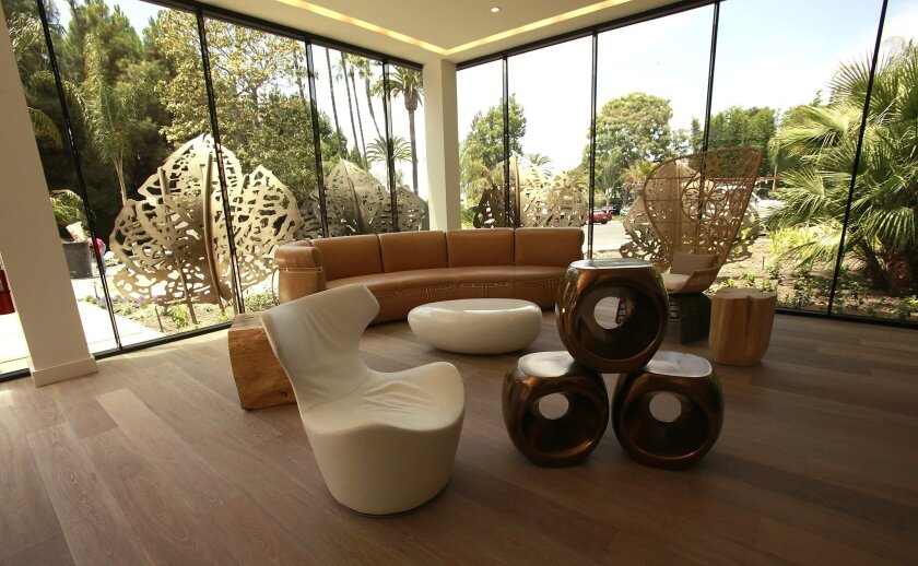 Hotel La Jolla's newly constructed lobby looks out onto a tropical landscape.