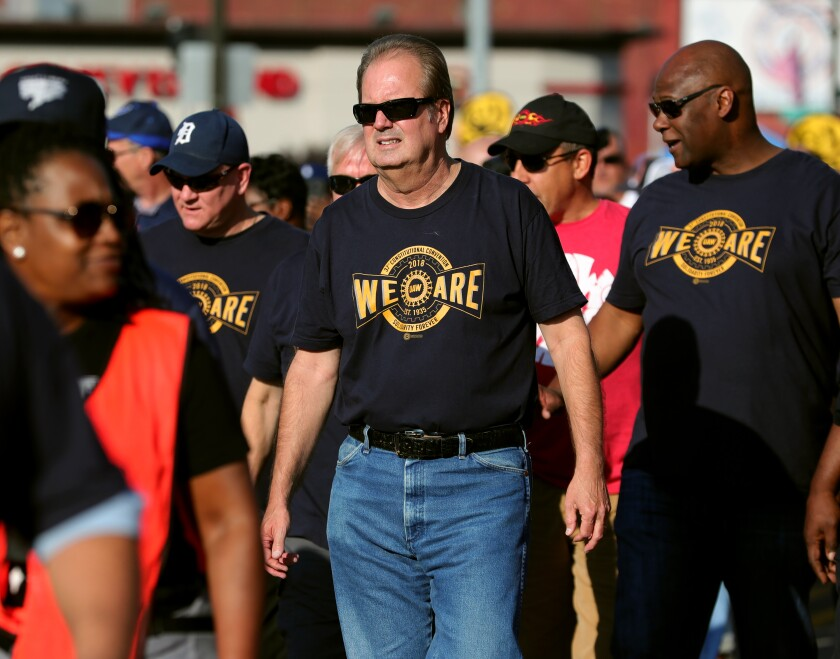 UAW President Gary Jones marches with union workers in the Labor Day parade down Michigan Avenue in Detroit.