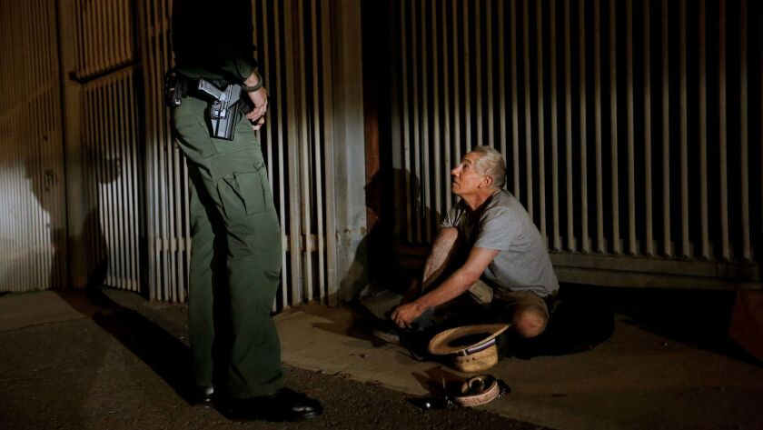 Eduardo Olmos of the U.S. Border Patrol agent, arrests a man trying to cross from Mexico.