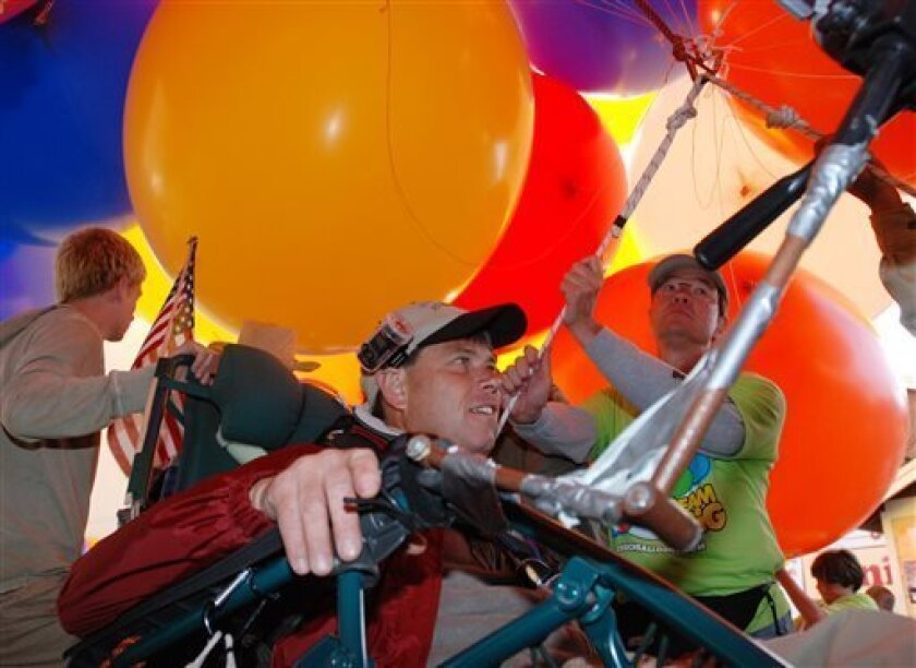 This July 5, 2008 file photo shows Kent Couch as he prepares to take off in his lawn-chair balloon from his gas station in Bend, Ore. Couch says that between the high cost of helium and a recent $4,500 fine from the Federal Aviatioin Administration, his flying days may be throughh - at least in the U.S. (AP Photo/Jeff Barnard)