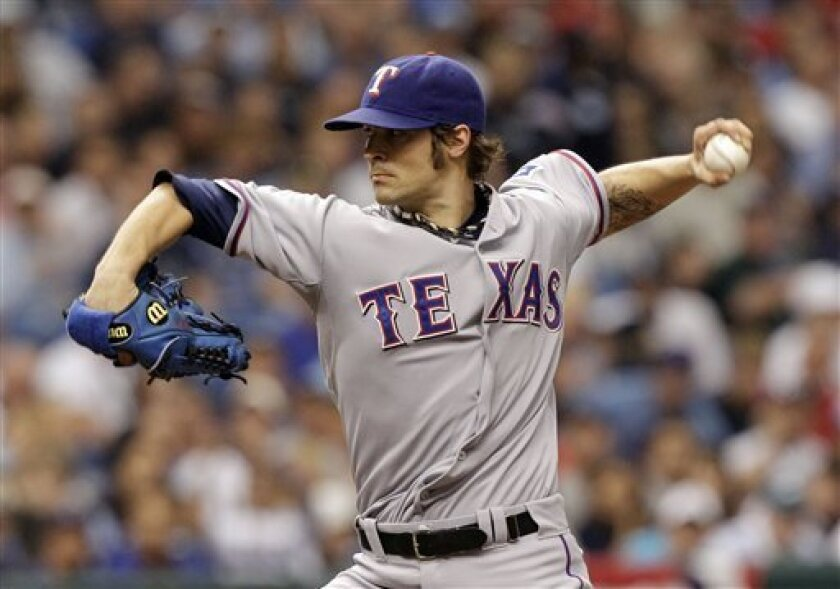 Texas Rangers' C.J. Wilson (36) pitches against the Tampa Bay Rays during the second inning of Game 2 of baseball's American League Division Series, Thursday, Oct. 7, 2010 in St. Petersburg, Fla. (AP Photo/Chris O'Meara)