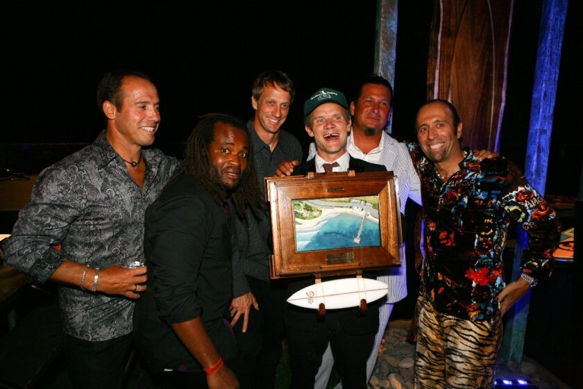 Aguerre (right) at a past benefit with (from left) brother Santiago, Sal Masekela of Fuel TV, professional skateboarder Tony Hawk, Flea of Red Hot Chili Peppers, and Izzy Paskowitz of Surfers Healing. Courtesy