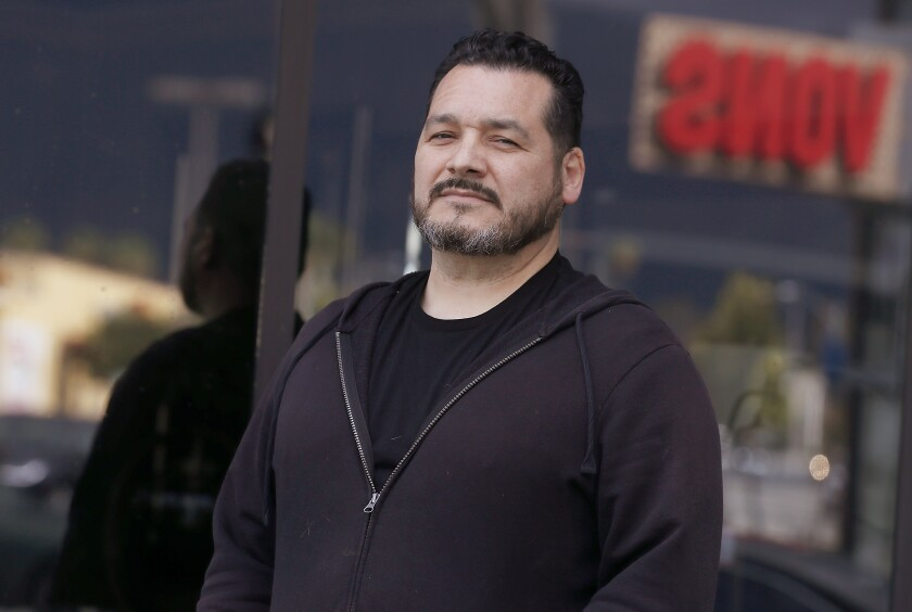 Grocery store employee Raymond Lopez