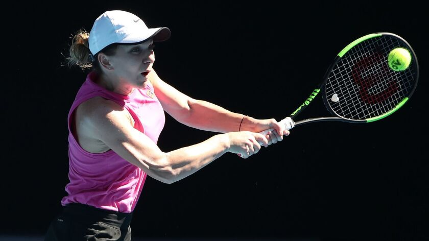 Simona Halep of Romania plays a shot during a practice session at Melbourne Park ahead of the Australian Open.