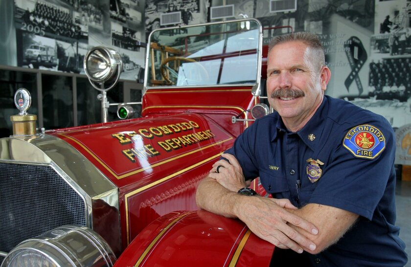 May 31, 2016, Escondido, California, USA_  Portrait of retiring Escondido Fire Chief Mike Lowry with the department's 1924 fire engine that's used in parades and displays. His last day of work is Friday.   Mandatory Photo Credit: Photo by Charlie Neuman/San Diego Union-Tribune/©2016 San Diego Union