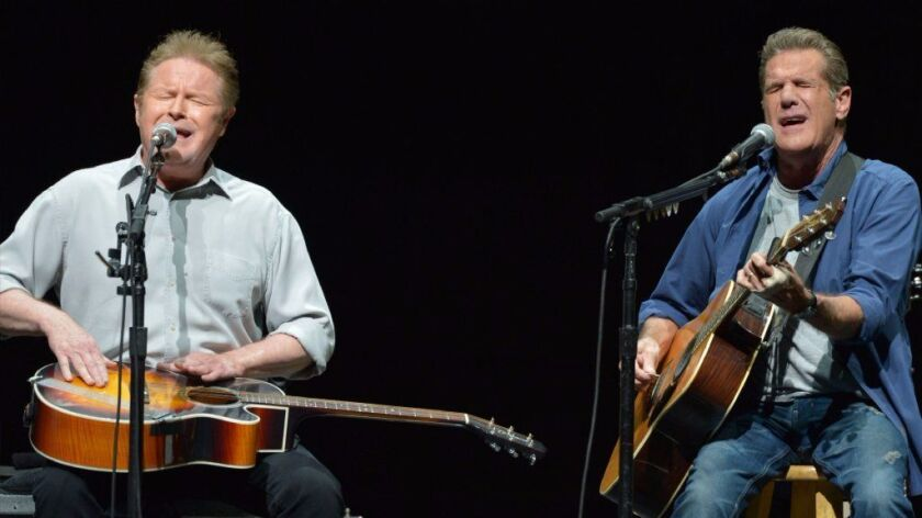 FILE - In this Jan. 15, 2014 file photo, Don Henley, left, and Glenn Frey of The Eagles perform at the Forum in Los Angeles.