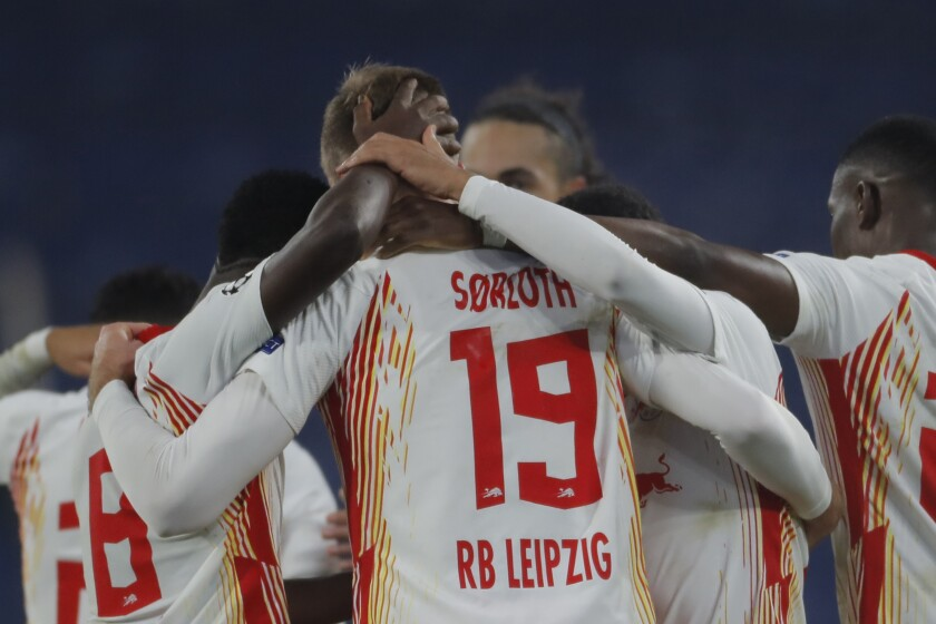 Leipzig's Alexander Sorloth, center, celebrates with teammates his side's fourth goal during the Champions League group H soccer match between Istanbul Basaksehir and RB Leipzig at Fatih Terim Stadium in Istanbul, Wednesday, Dec. 2, 2020. Leipzig won 4-3. (AP Photo)