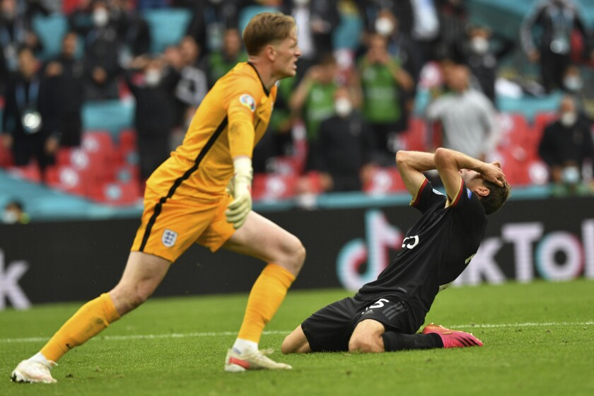 Germany's Thomas Mueller reacts after a miss in front of England's goalkeeper Jordan Pickford during the Euro 2020 soccer championship round of 16 match between England and Germany at Wembley Stadium in England, Tuesday June 29, 2021. (Justin Tallis, Pool Photo via AP)