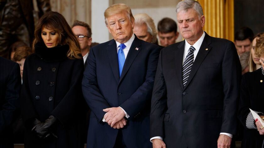 President Trump with First Lady Melania Trump and Franklin Graham during a ceremony honoring Billy Graham in 2018.