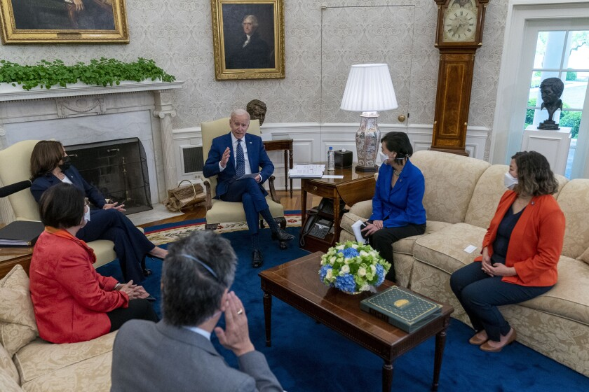 Biden and Harris meet with members of the Congressional Asian Pacific American Caucus on April 15.