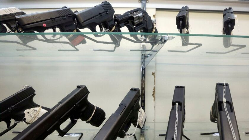 Handguns for sale are displayed at a Miami gun store in 2016.