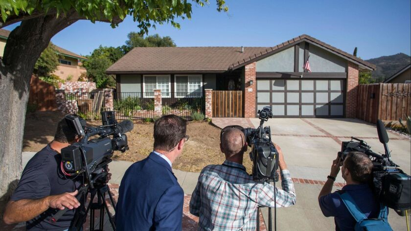 Journalists wait outside of the home of shooter Ian David Long in Thousand Oaks.