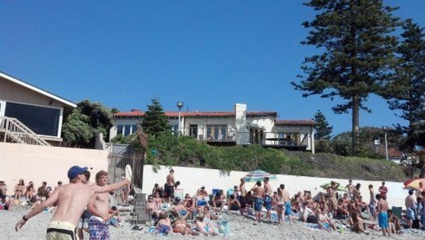 The beach in front of former presidential candidate Mitt Romney's home as seen on a busy holiday weekend in 2012. File